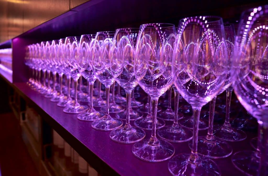 Row of champagne flutes on shelf